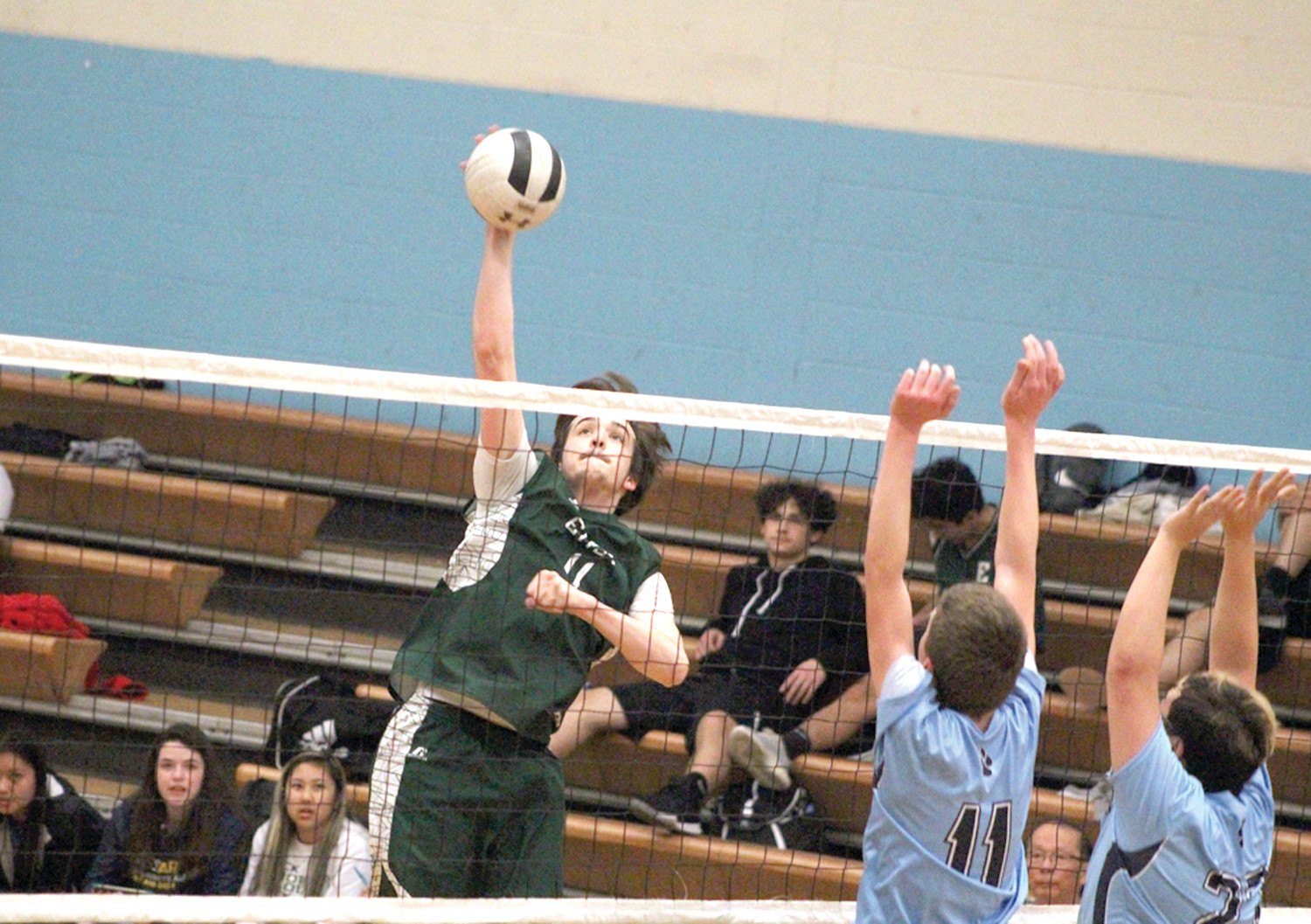 SOARING UP: Cranston East's Jacob Glantz takes to the air for a spike during the Thunderbolt's win .