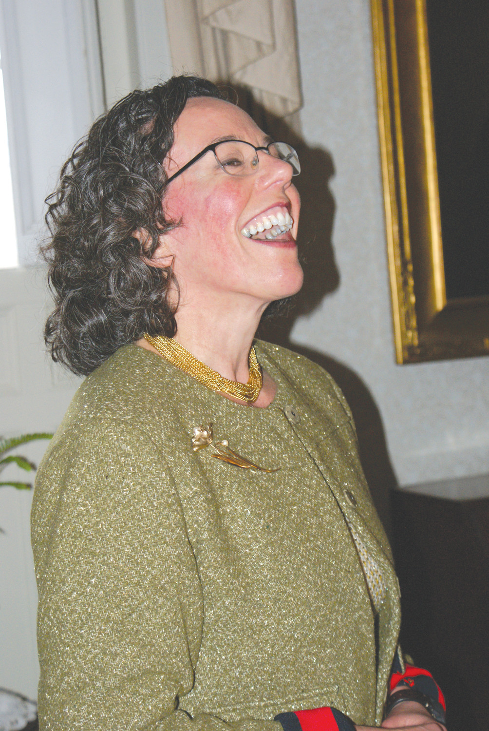 A HAPPY PRESENTER: For the first time in the Annual Victorian Tea, sponsored by the Cranston Historical Society, featured Laura Johnson, Ph.D., a Curator at the Eustis Estate in Milton, Mass. who is seen reacting to a comment by a guest.