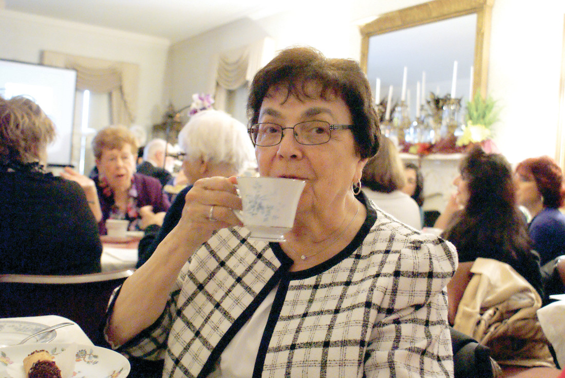 THE TASTE OF TEA: Enjoying her cup of tea during the 4th Annual Victorian Tea, sponsored by the Cranston Historical Society and help in Sprague Mansion was Marie Sanda. She has attended every Victorian Tea.
