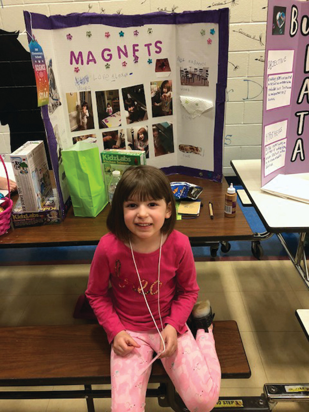 HOW DO THEY WORK?: Alexandra Henner, Grade K, with her science project on the workings of magnets.