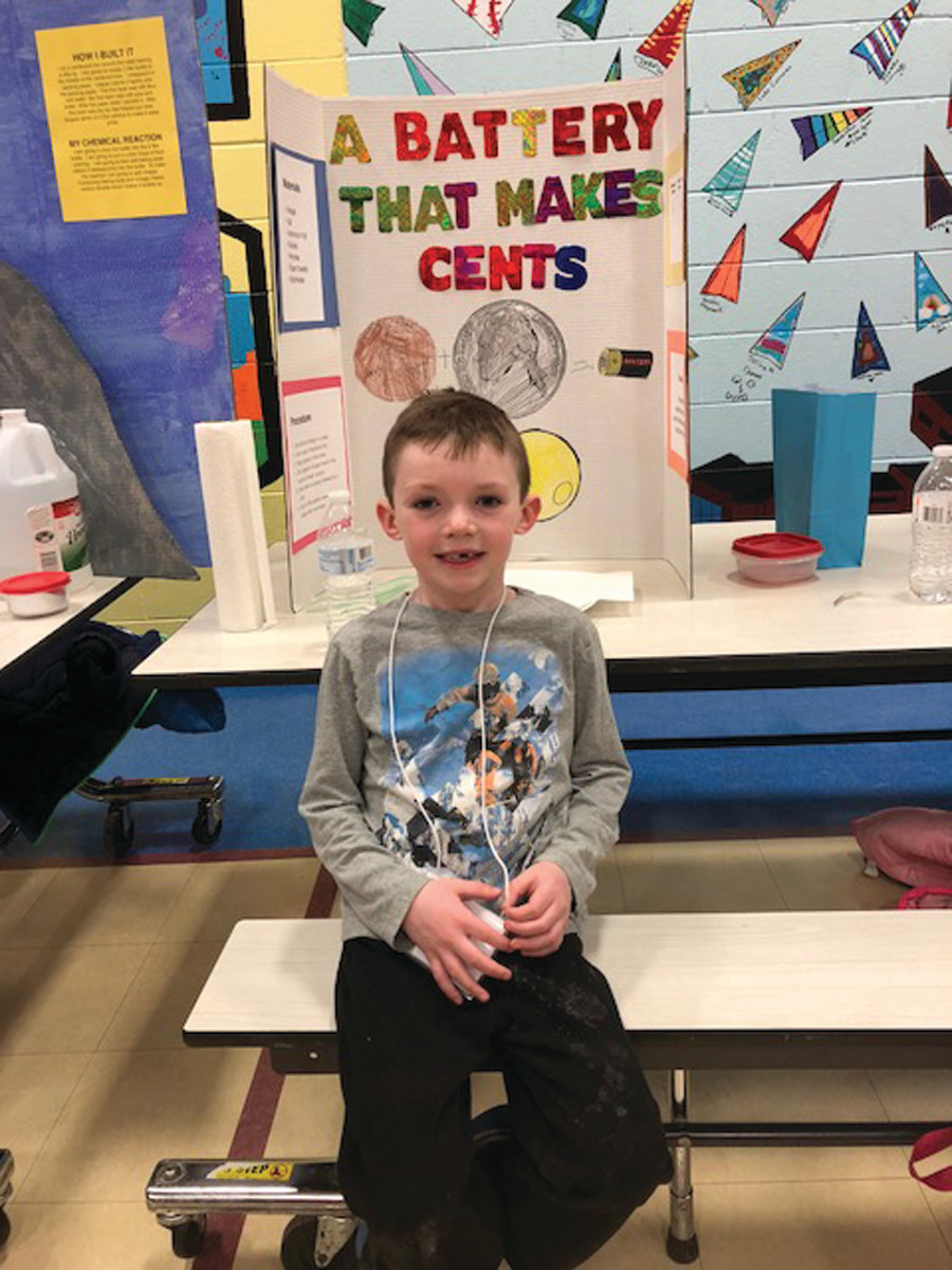 CHARGED UP: Blake McEnery, Grade K, with his science fair project on batteries.