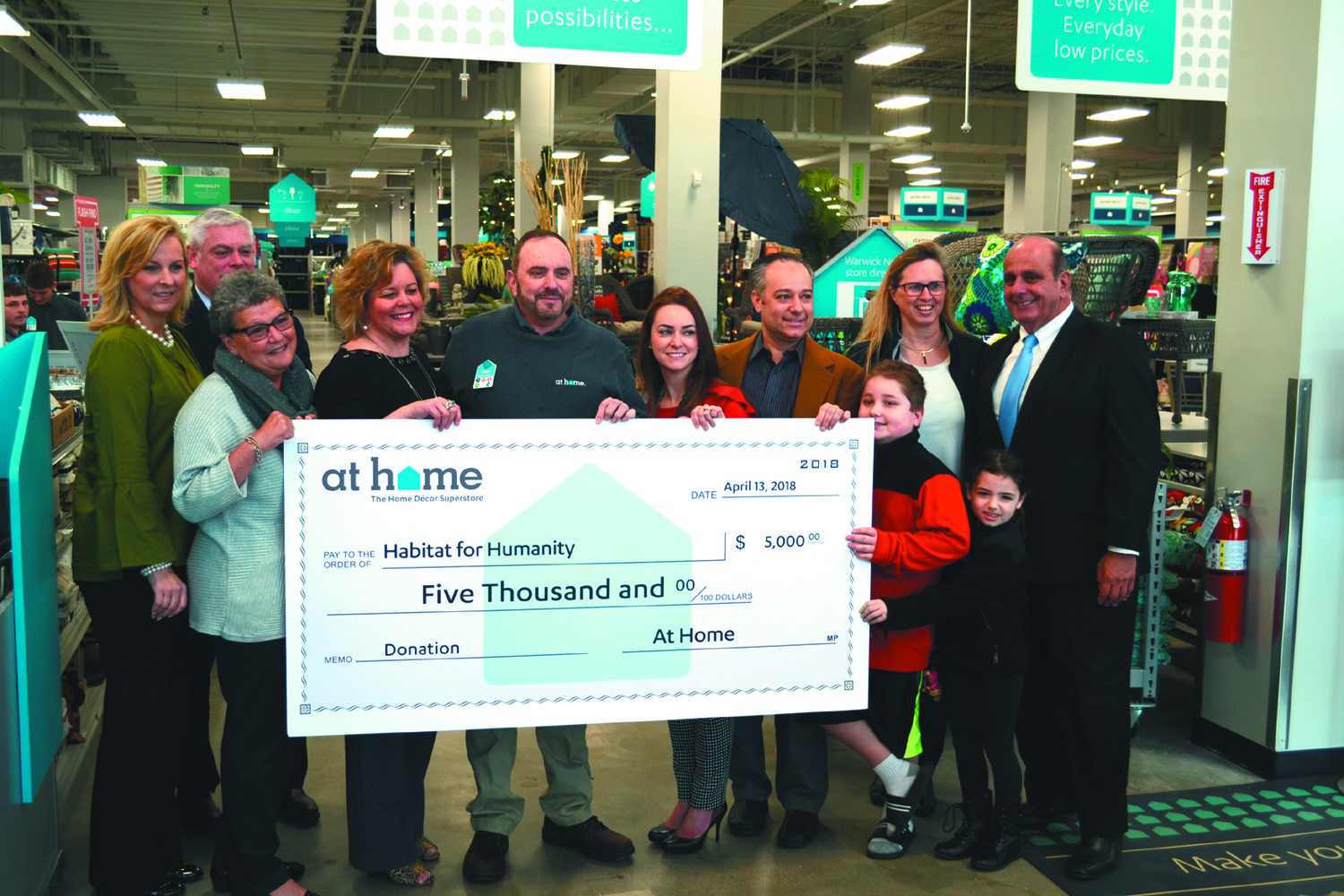 FOR A GOOD CAUSE: At Home's corporate offices donated $5,000 to the local branch of Habitat for Humanity, and the store's employees kicked in another $500.