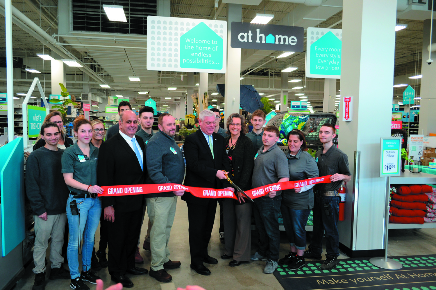WELCOME HOME: Mayor Scott Avedisian clips the ribbon on At Home's new location in Rhode Island Mall. The décor superstore had to move from its original location off Bald Hill Road following a legal dispute with Home Depot.