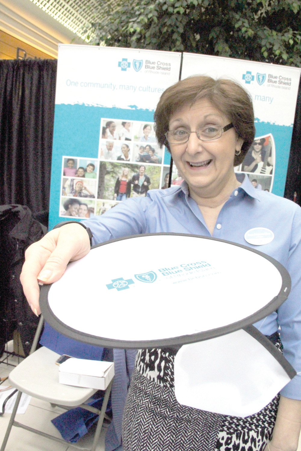 HOW TO STAY ACTIVE: At the Blue Cross/Blue Shield booth Susan Saccoccia Olson handed out foldable Frisbees.