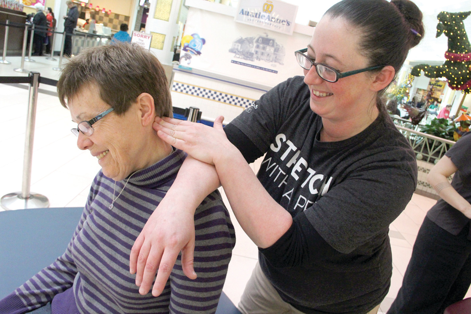 RELAXED: Alice Anderson loosens up under the hands of Sarah Jarvis of Massage Envoy that had a display at the mall.