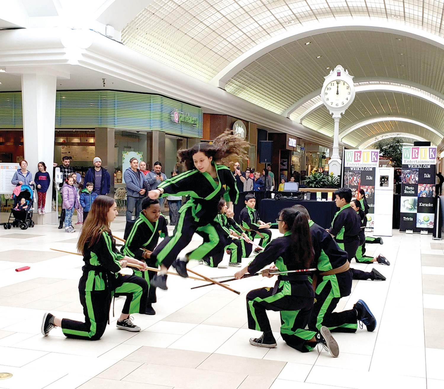 IN THE AIR: The Students of Premier Martial Arts RI of Cranston took to the air in their performance at last Thursday's Family Expo at Warwick Mall.