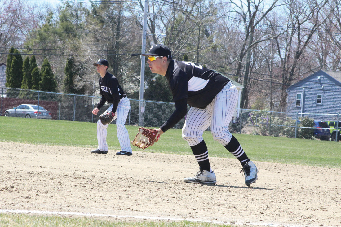 First baseman Kyle Denis prepares to field a ground ball against Cranston East on Saturday.