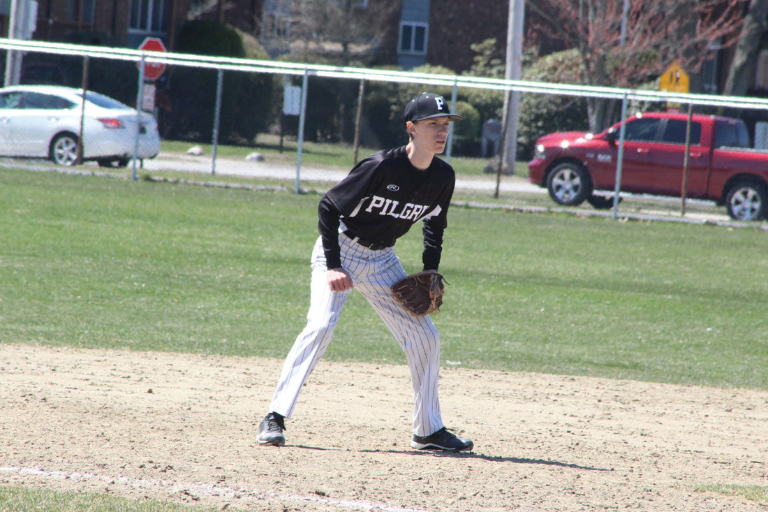 AT THE READY: To the left, Pilgrim third baseman Andrew Merryfield keeps ready in the infield.
