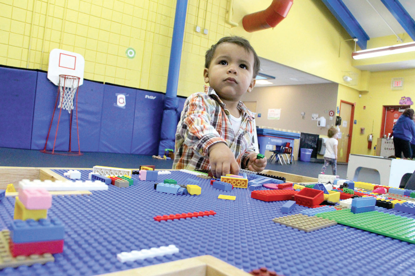 NEVER TOO YOUNG FOR LEGOS: Robert Kilgore, 18 months old of Warwick, can't resist playing at the Lego table.
