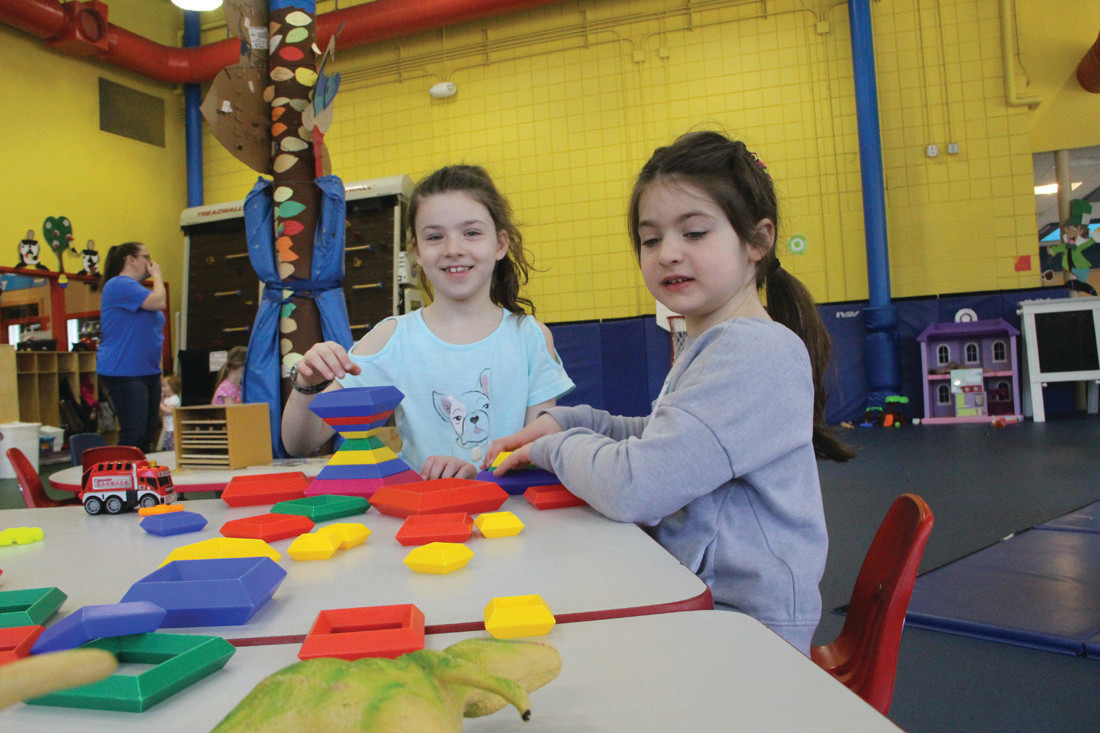A BLOCK PARTY: Althea Selby and her sister Scarlet of Scituate build pyramids.