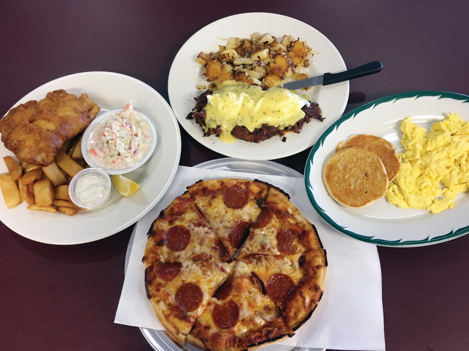 "The only way to fully experience this show-stopping array of dishes ~ Fish & Chips, a pepperoni pizza, a ""rodeo"" burger and a classic Hash Eggs Benedict ~ is to visit M & M's Diner and Pizzeria, now open at 1031 Plainfield Street."