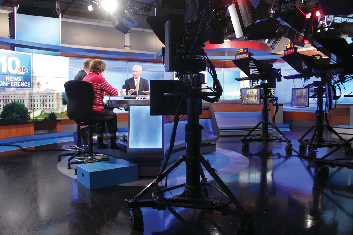 BACK ON THE SET: Former Senator, Governor and Democratic candidate for president Lincoln Chafee has all but officially announced he is looking to return to the U.S. Senate. He is seen here in the Channel 10 studio with political reporter Bill Rappleye and Arlene Violet during the taping of Sunday's 10 News Conference.