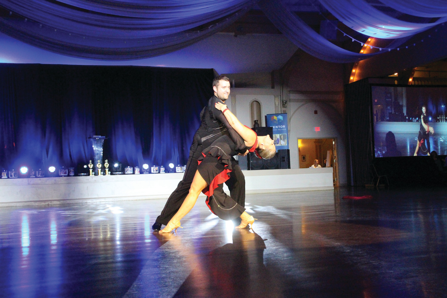 Angela Ciresi of Ciresi Chiropractic gets dipped by partner Noah Carsten in one of the many stunning scenes of the evening.