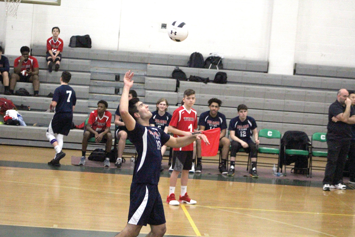 Max Laiter serves the ball for Toll Gate.