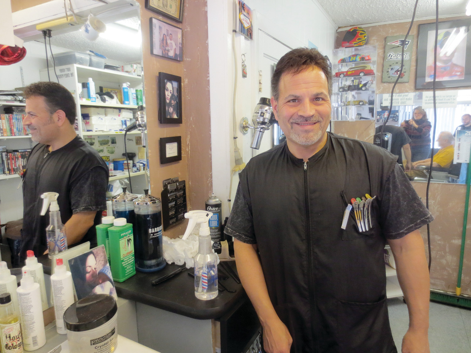 "Meet Dave Picozzi of David's Greenwood Barber Shop, seen here in his barber shop on Post Road ~ the place he has called his ""second home"" for nearly 25 years."