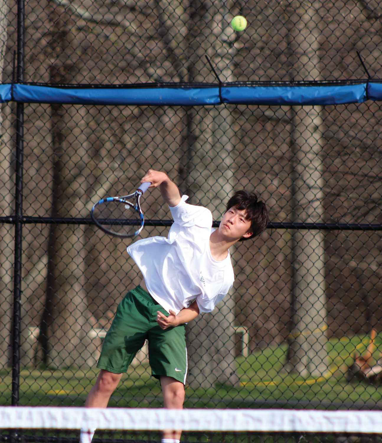 Ben Kim sends a shot over the net in his doubles match.