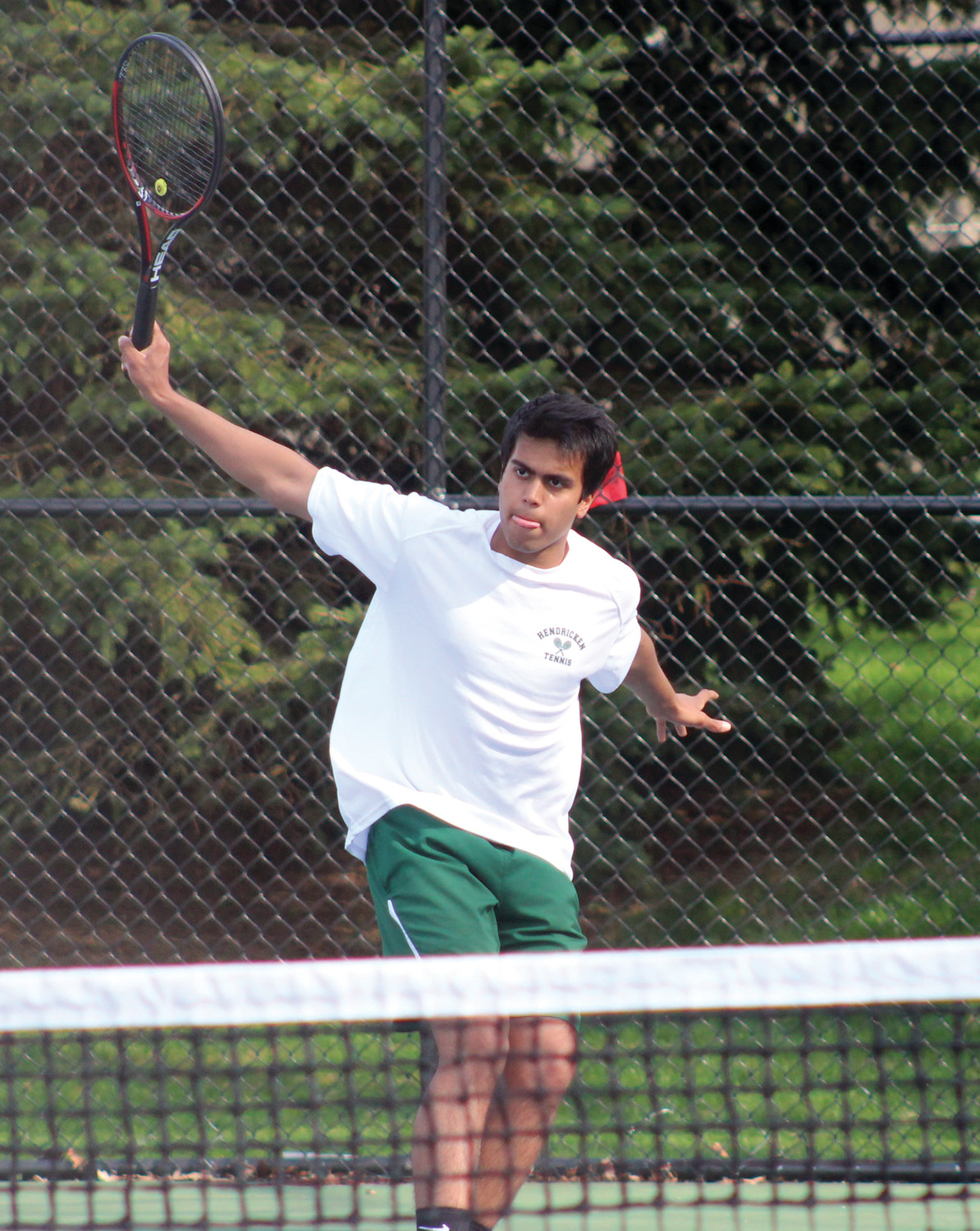RETURN FIRE: Bishop Hendricken's Aditya Kimi fires a shot against North Kingstown.