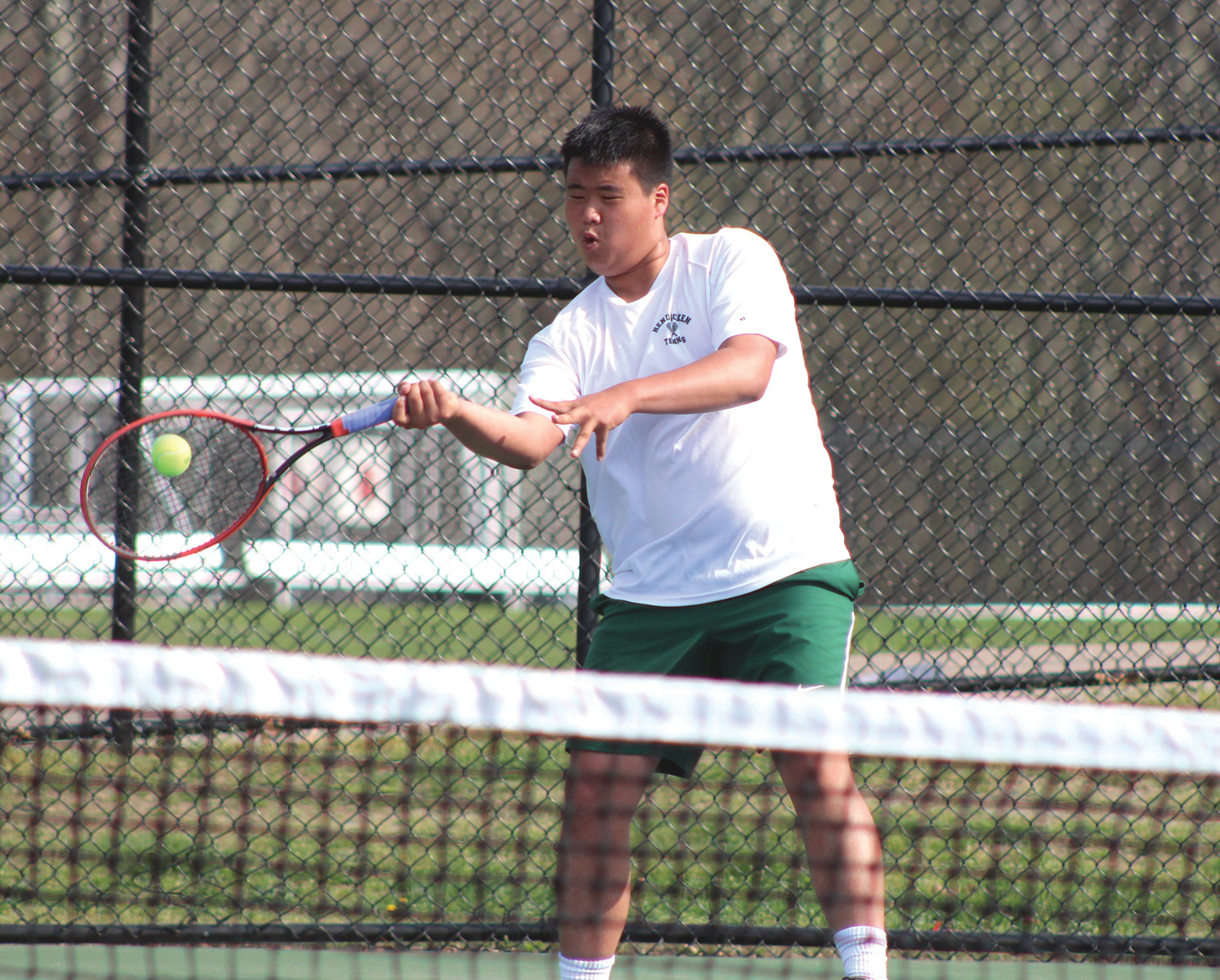 BOUNCE BACK: Bishop Hendricken's Ken Lee returns a shot against North Kingstown.