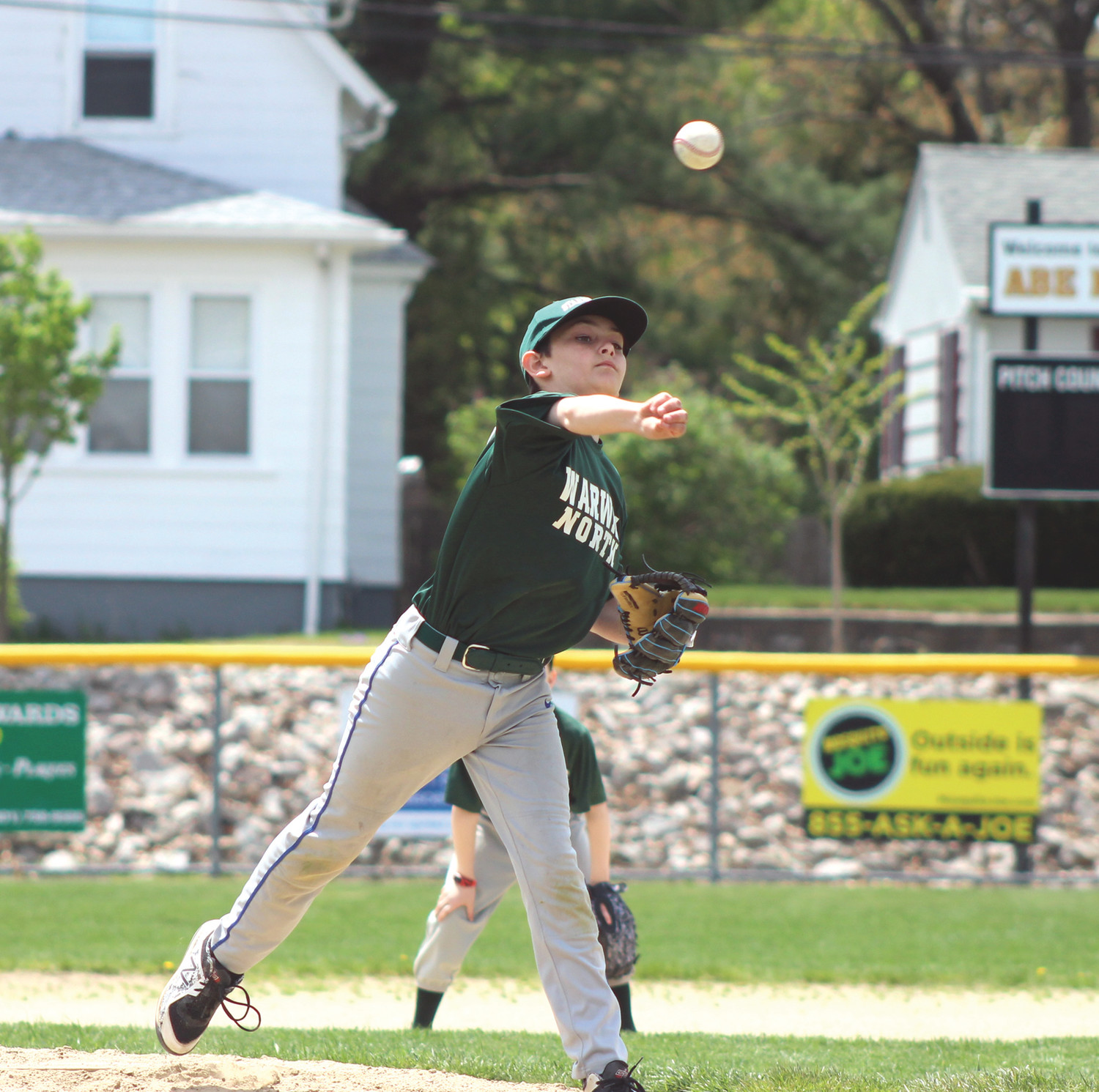 Jacob Oliveira of Crusty's Pizza delivers a pitch in the first inning on Saturday afternoon.
