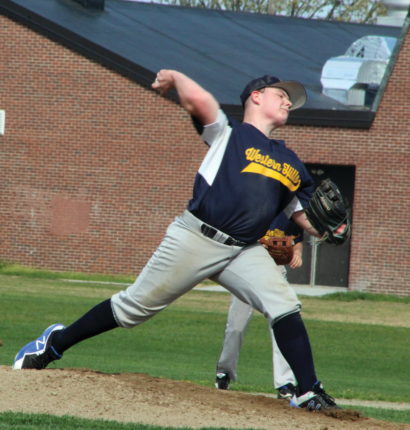 ON THE HILL: Western Hills' Evan Dacey delivers a pitch against Vets.