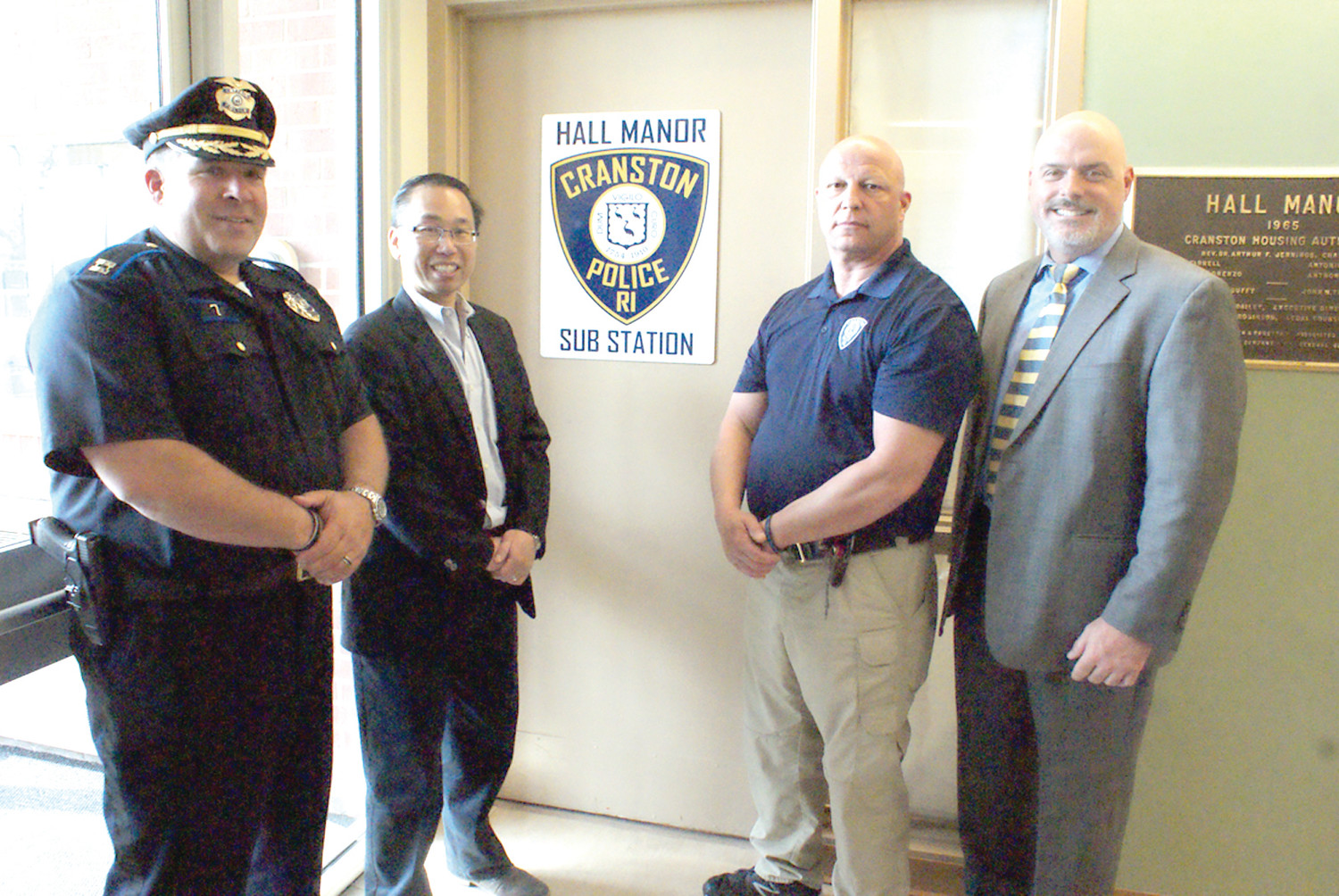 WELCOMING A NEW SUBSTATION:  The Cranston Police department in coordination with the Cranston Housing Authority have converted a former reading room at the Hall Manor on Warwick Ave. into a Police Substation. Standing in front of the new Substation Door are Capt. Vincent McAteer, Mayor Allen Fung, Patrol Sgt. Jeff Chapman and the Executive Director of the Cranston Housing Robert J. Coupe.