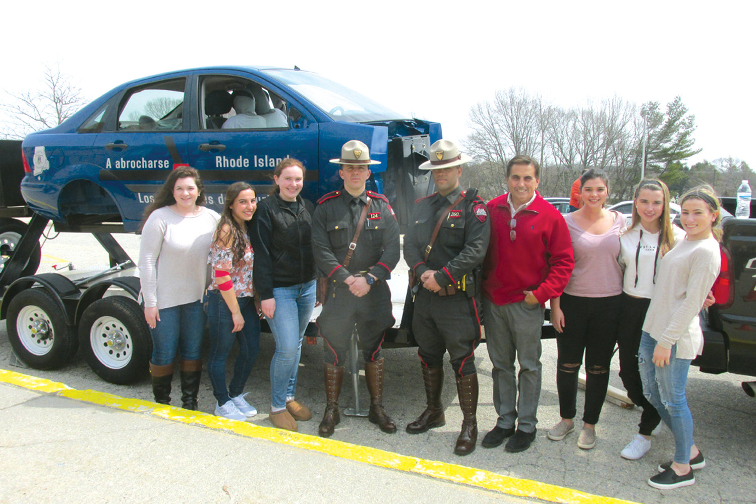 SADD STAFF ON HAND: Members of Johnston High's Students Against Dangerous Decisions that took part in a recent mock car crash and roll over with Rhode Island State Troopers LJ Fiorenzano and Juan Coronado, are from left: Emily Watson, Lauren Messa, Allison Vessella, Advisor Greg Russo, Allyssa Johnston, Madison Plouffe and Jordan Moretti. (Sun Rise photos by Pete Fontaine)