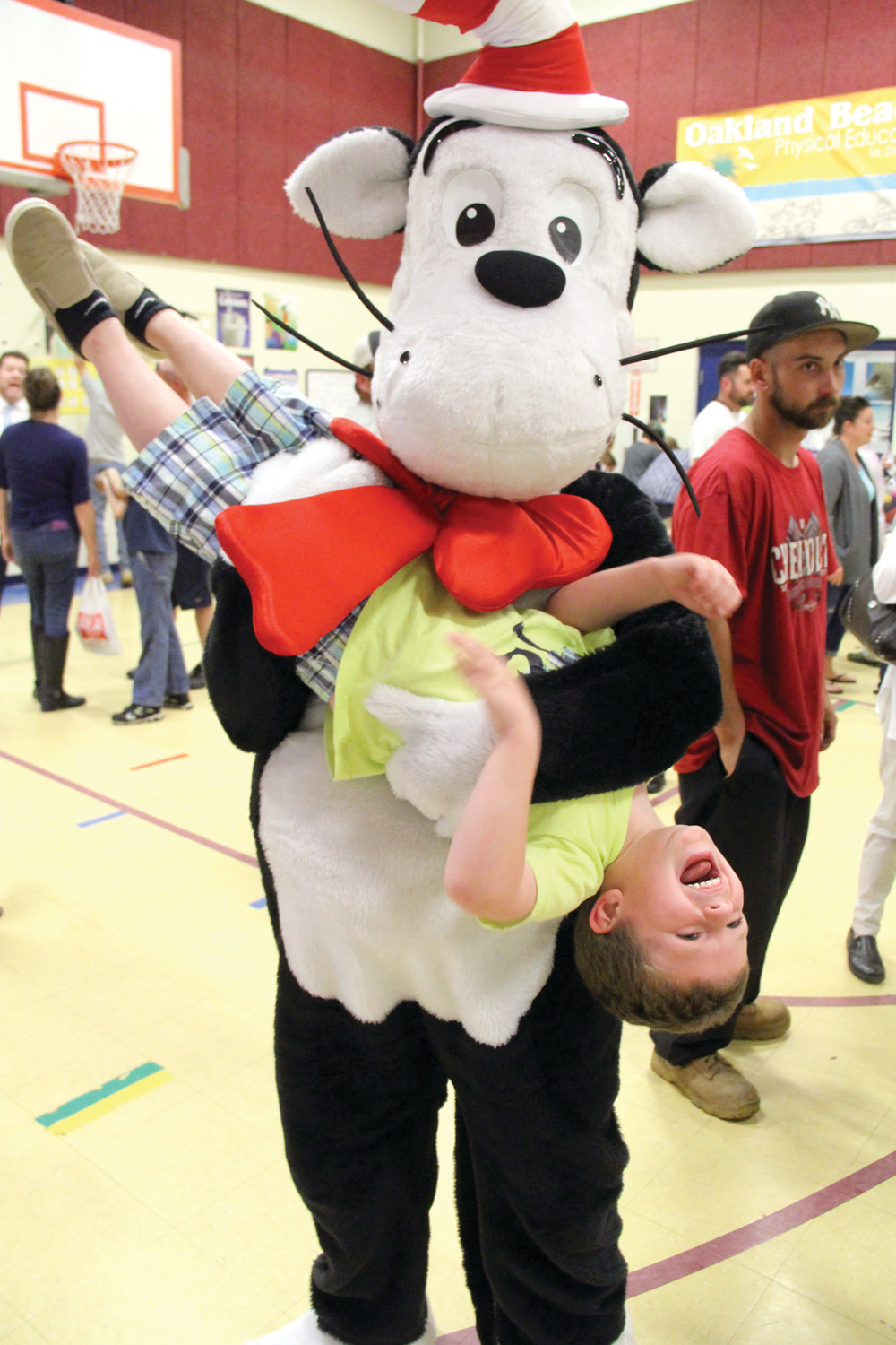 GOTTA WATCH THAT CAT: To his delight, pre-schooler Jayden Cahoon is turned upside down by the Cat in the Hat.