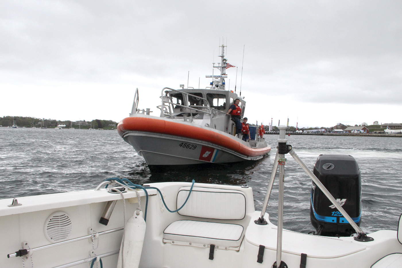 READY TO BOARD: A Coast Guard vessel was in our wake, preparing to board.