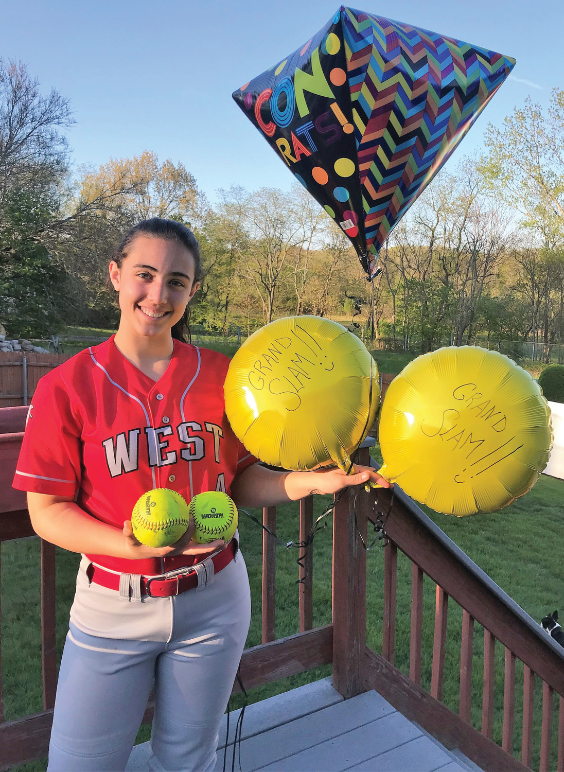 BIG GAME: Cranston West's Haley Travieso celebrates after her 10 -RBI game last week.