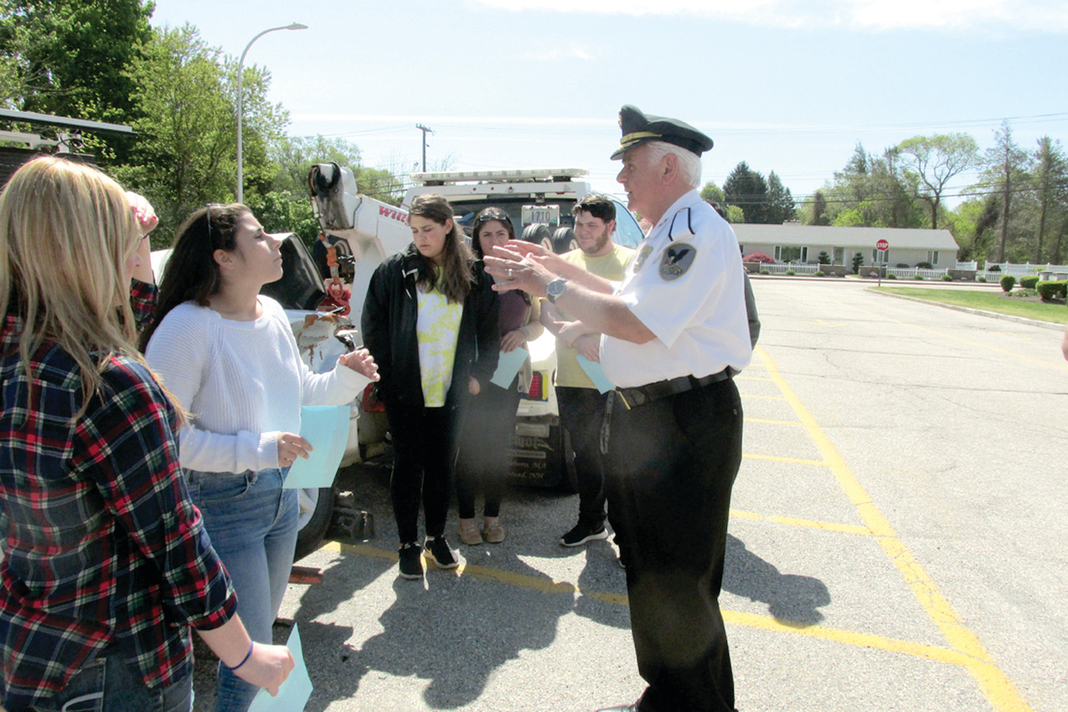 "PROM PROMISE: Johnston Police Chief Richard S. Tamburini tells this group of JHS students to ""Make your prom memorable, not a memorial"" and then said deal to which the group replied in unison ""Deal!"""