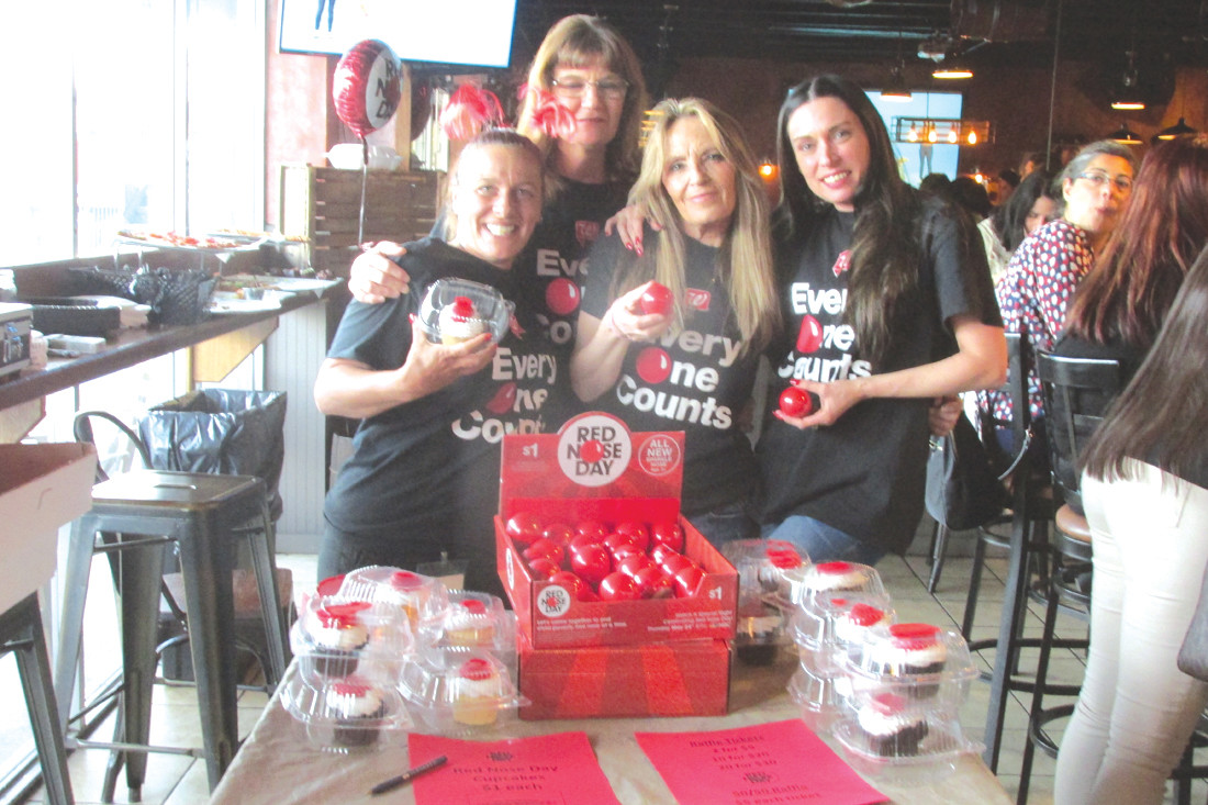 FUN(D)RAISERS: Kristy Pistacchio (right), manager of Walgreens on Plainfield Pike, and super staffers like Alicia Mekuto, Cheryl DiMaio and Maryellen Dolman helped host the 3rd Annual Red Nose Ladies Night at Bar 101 that raised $850 for help fight against children in poverty. (Sun Rise photos by Pete Fontaine)