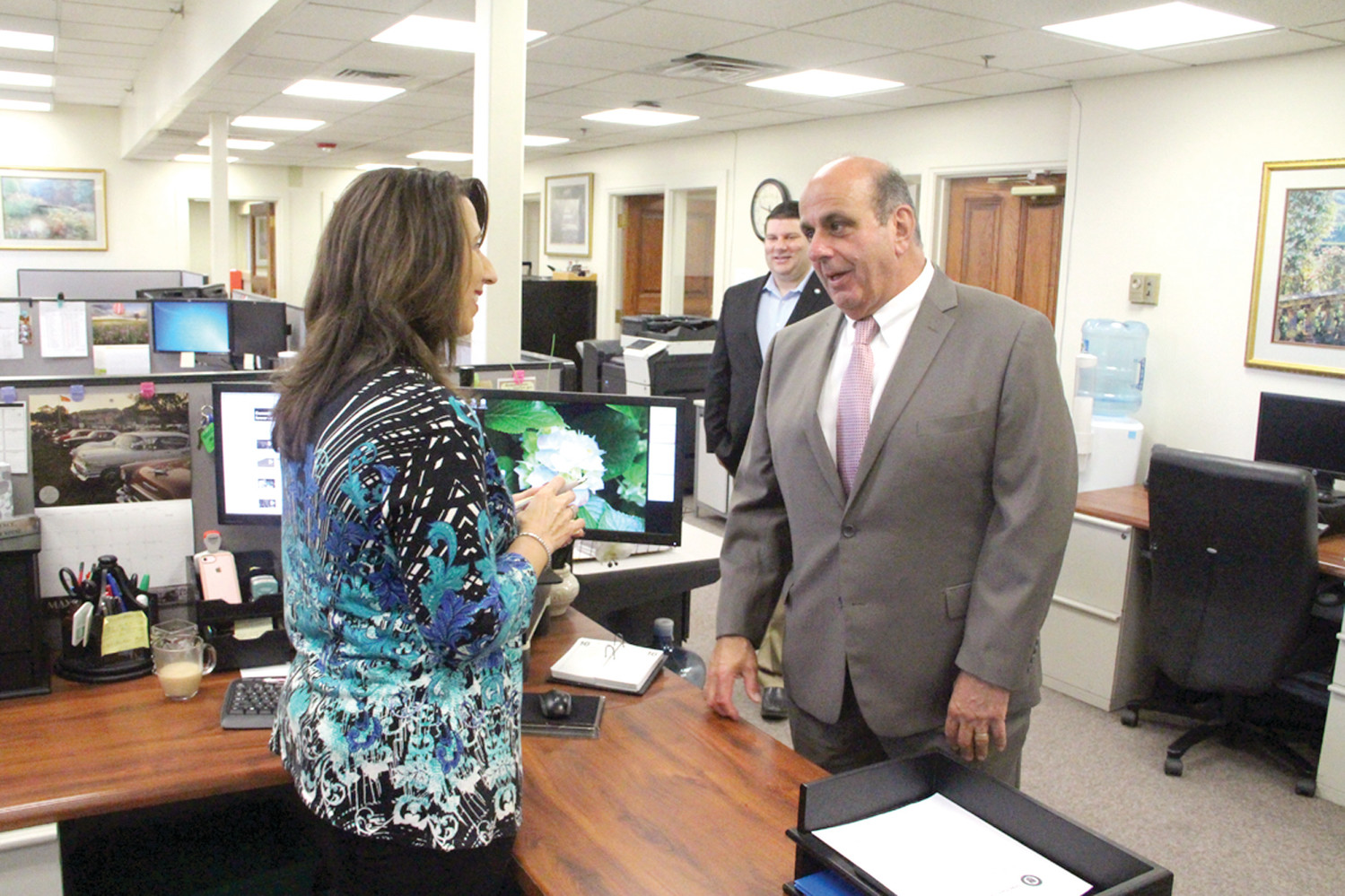 MAKING THE ROUNDS: Acting Mayor Joseph Solomon was joined by Ward 7 Councilman Steve McAllister as he met city employees yesterday. Here he talks with Margie White in the finance department.