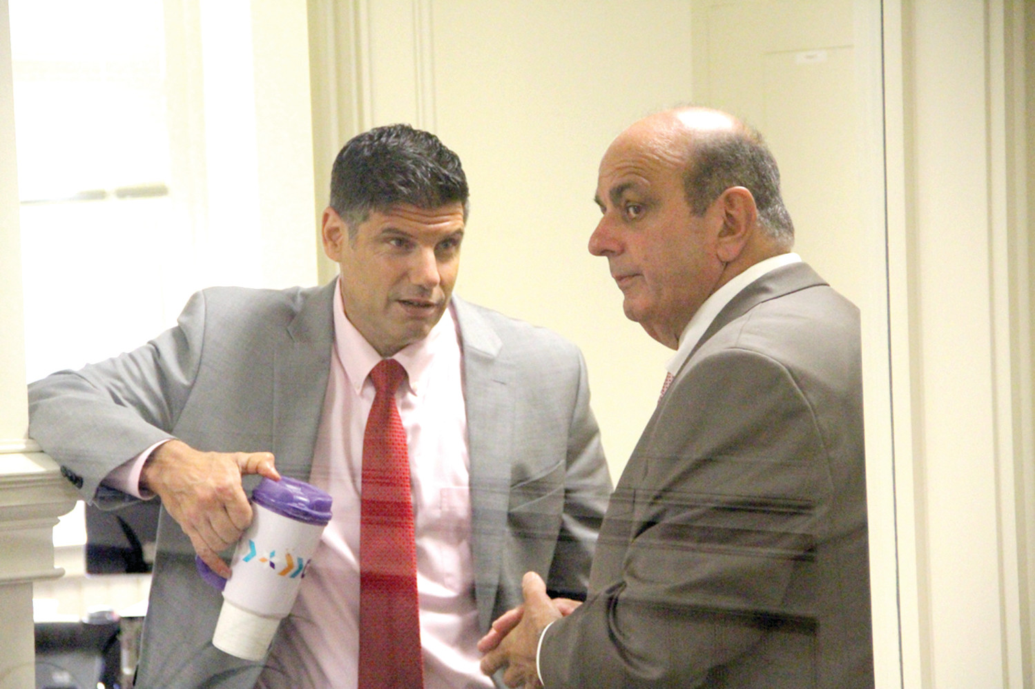 TETE A TETE: Acting Mayor Joseph Solomon and his newly named chief of staff, City Planner William DePasquale,  confer in the corridor outside DePasquale's office.