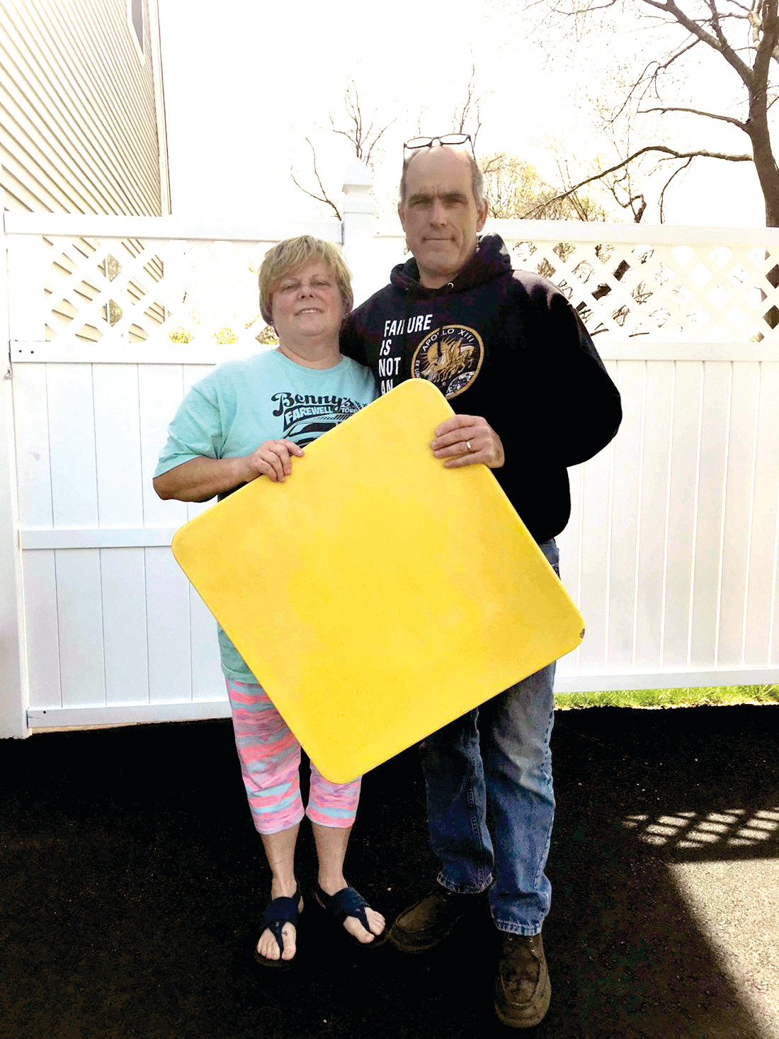 NOW: Norm and Jodie Tellier hold the rescued tabletop containing their love note