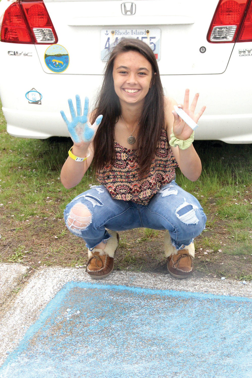 BLUE EVERYWHERE: Destinee Charette was blue by the time she was finished on her sidewalk art.