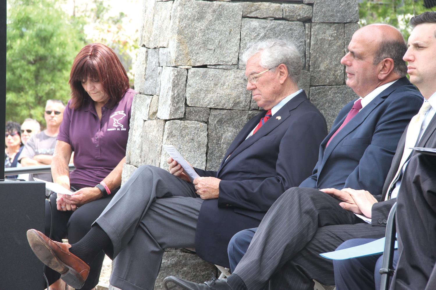 A SOLEMN OCCASION: Gina Russo, president of the Station Fire Memorial Foundation, former Gov. Donald Carcieri, Warwick Acting Mayor Joseph Solomon and General Treasurer Seth Magaziner listen to remarks during Sunday's observance.