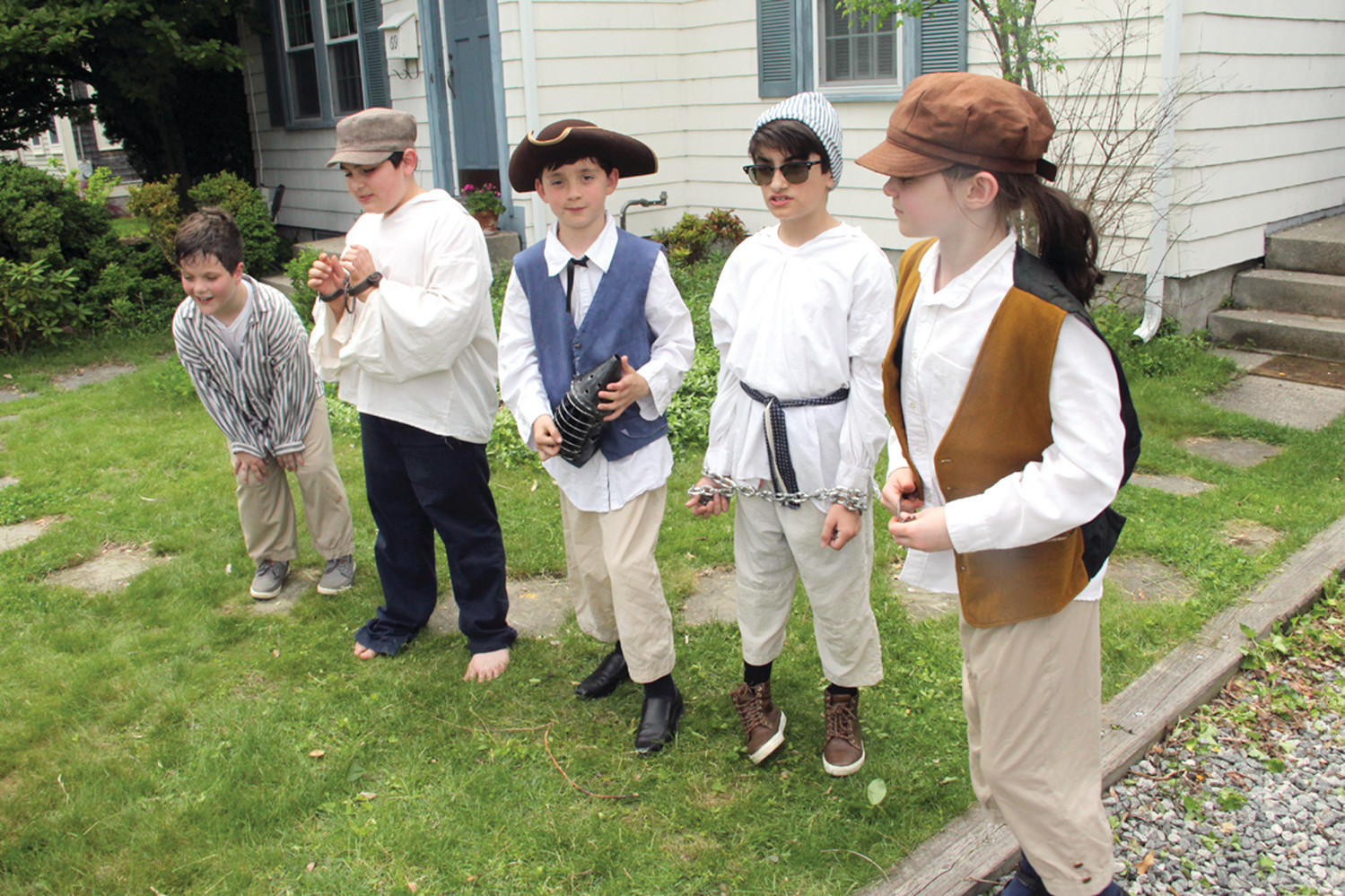 JAIL HOUSE GANG: When those on tour learned a hog went missing in the village and a suspect had been apprehended, they looked on as justice played out. Playing various roles from left were Joshua Mahoney, Liam Meehan, Joshua Pacheco and Beth Vitale, the bailsman.