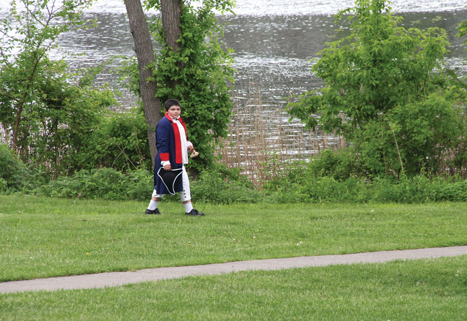 CALLING IT A DAY: Finn Meehan heads for the Aspray Boathouse to change after the last tour visited the Gaspee Monument on Peck Lane.