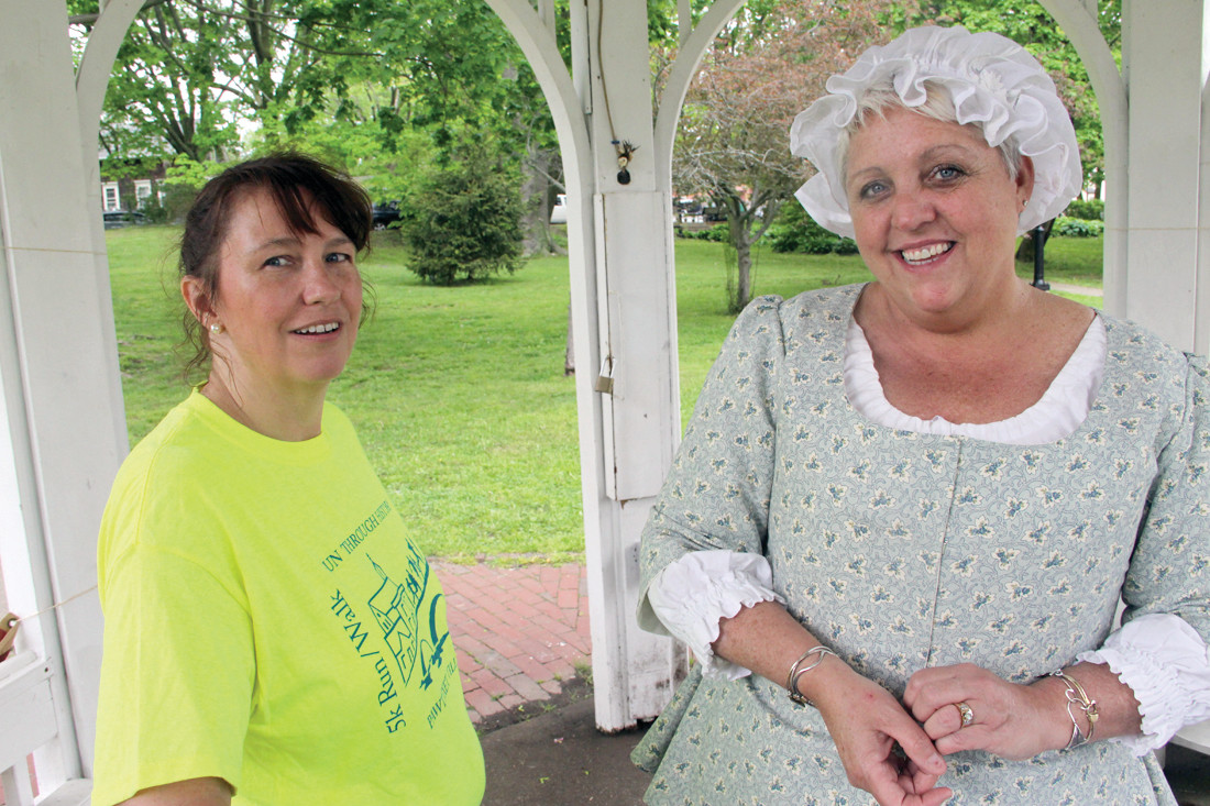 IT TOOK MANY: An estimated 100 volunteers in addition to the 65 students who played roles helped put the walking tour together, including Christine Desmaris and Toni Andersen seen at the park gazebo where tours started.