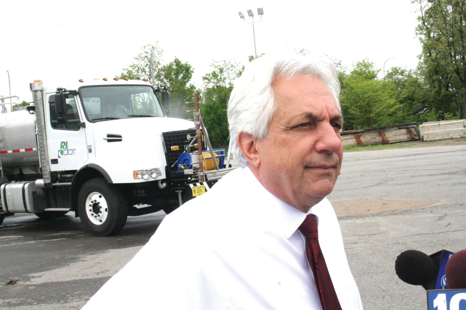 A MAN AND HIS TRUCK: Peter Alviti, the director of the DOT, talks about the trucks that will be used to clean Rhode Island's 1,179 bridges in the coming months.