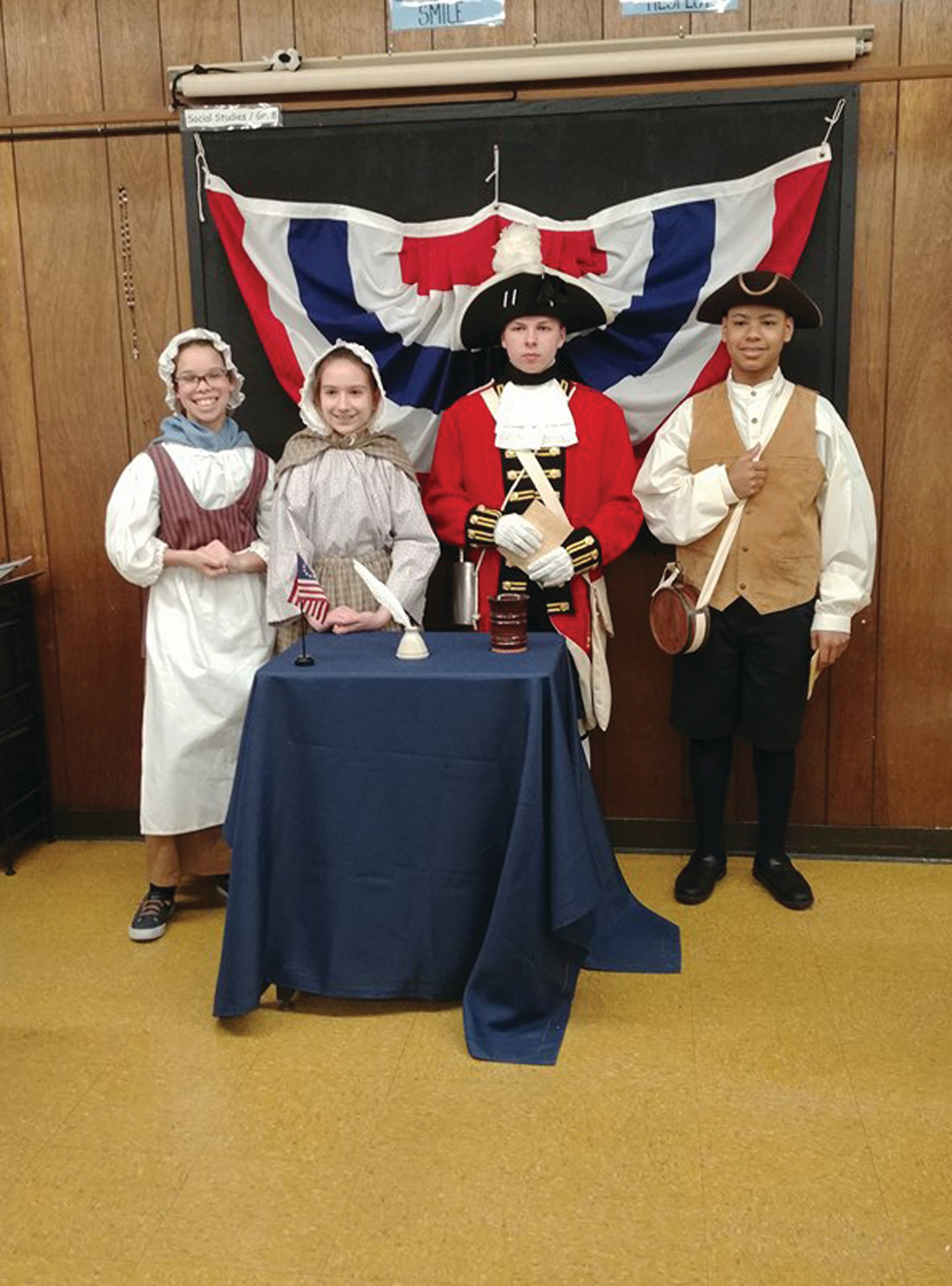 TODAY'S NEWS: Devin Aeid, Giancarlos Villavicenio, Kaitlyn Wojtyna, and Jazmin Pierce were being filmed presenting the day's news in full revolutionary period costume on a recent Thursday morning.