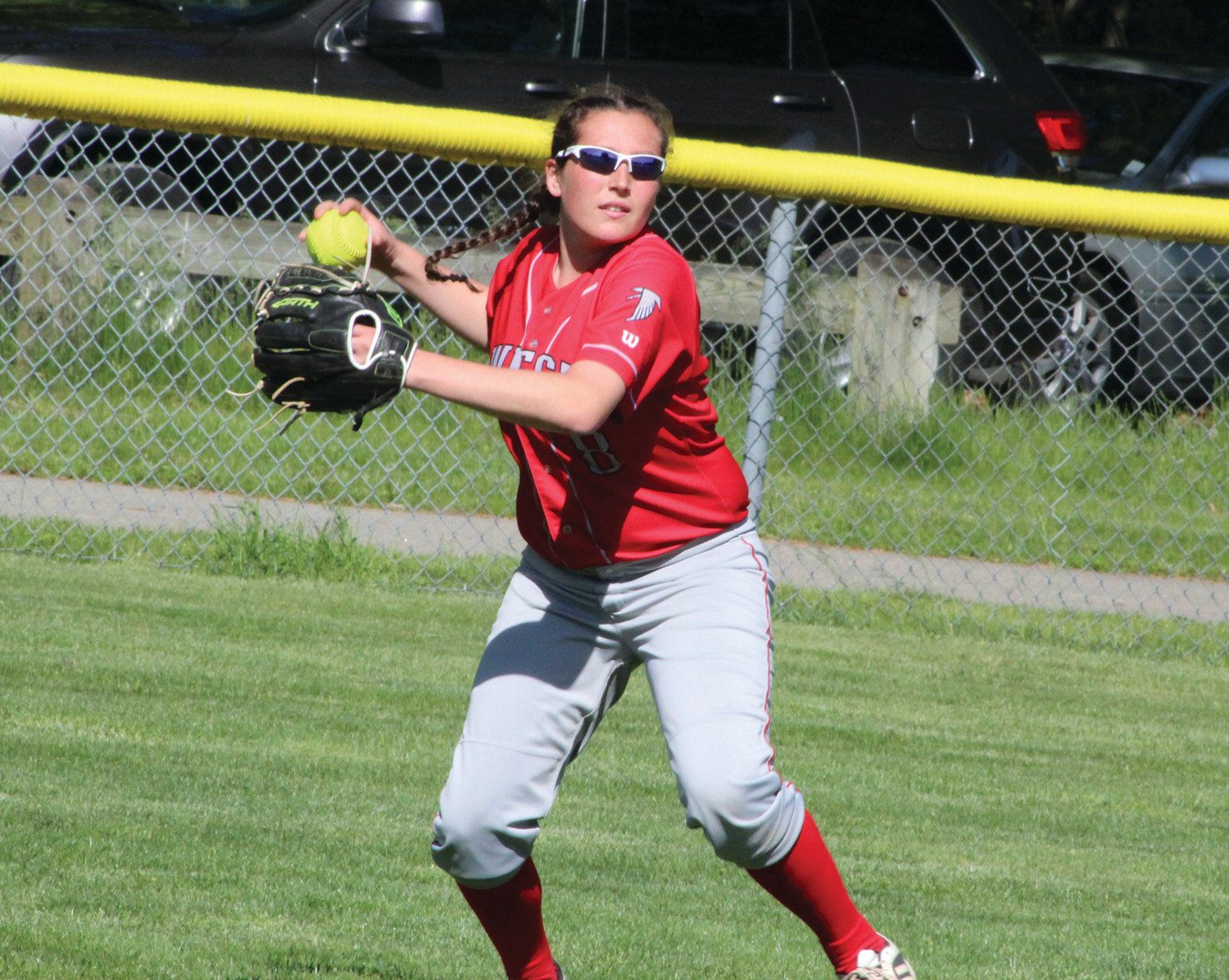 PLAYING THE FIELD: Cranston West's Caitlin O'Brien makes a play in the outfield against Pilgrim.