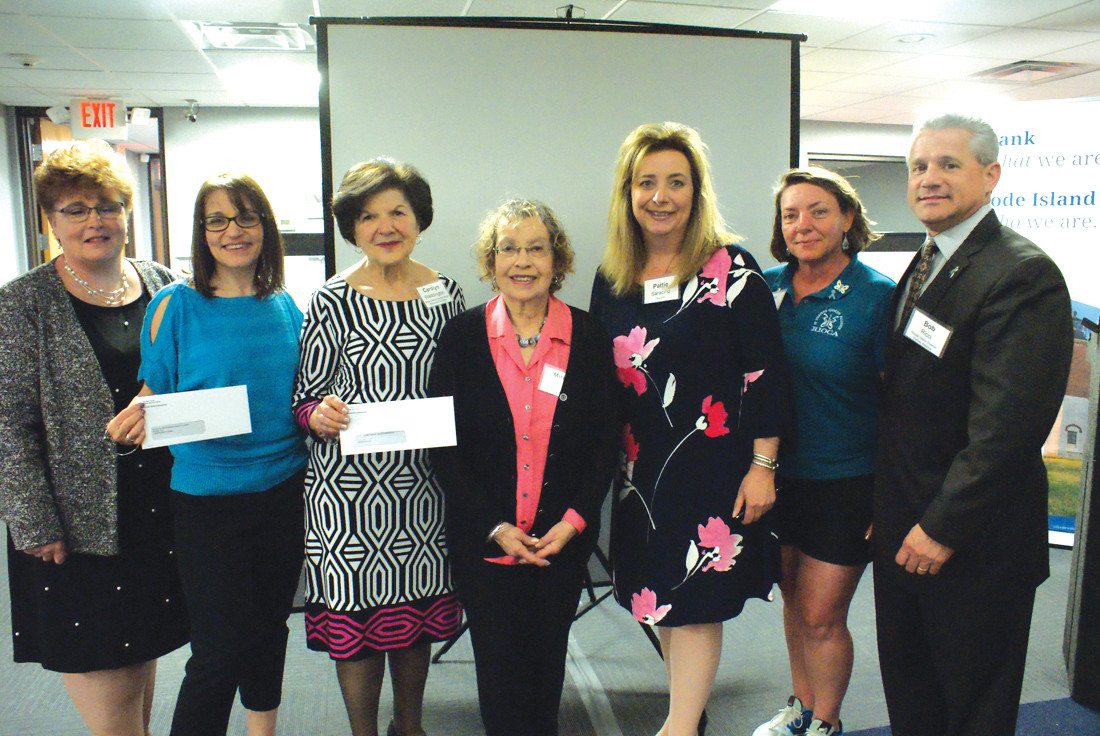 PRESENTATION: Two $2,500 checks were given during the Women's Wellness Night by BankRI: one to the RI Ovarian Cancer Alliance and one to the Gloria Gemma Breast Cancer Resource Foundation. Representing the various organizations were (l-r) Sheila Hagen, Donna Ricci, Carolyn Waddington, Miriam Plitt, Patti Saracino, Ann Hall and Robert Ricci.