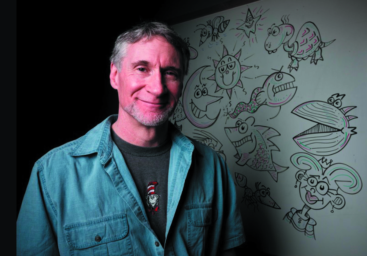 LIGHT CONDUCTOR: Steve Brosnihan, resident cartoonist for Hasbro Children's Hospital in Providence, started Good Night Lights with nothing more than the flashlight on his bicycle. It has expanded into something much more amazing since.