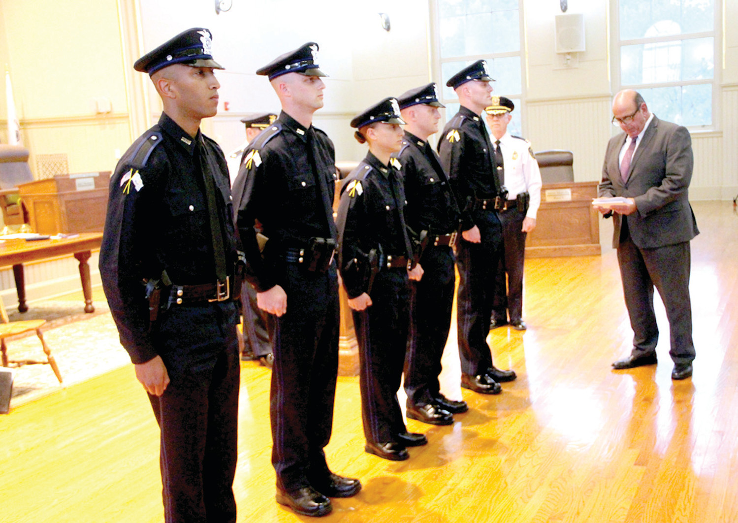 NEW TO DEPARTMENT: Probationary police officers (from left) Michael Bailey, Kyle Fitzsimmons, Sara Goes, Ben Bratko and Ryan Shibley prepare to take the oath of office as administered Tuesday night by Acting Mayor Joseph Solomon.