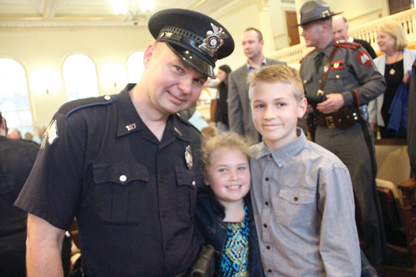 PROUD KIDS: Officer Tomas Bogusz who received the lifesaving award is congratulated by his children Maya and Olek at the conclusion of the ceremony.