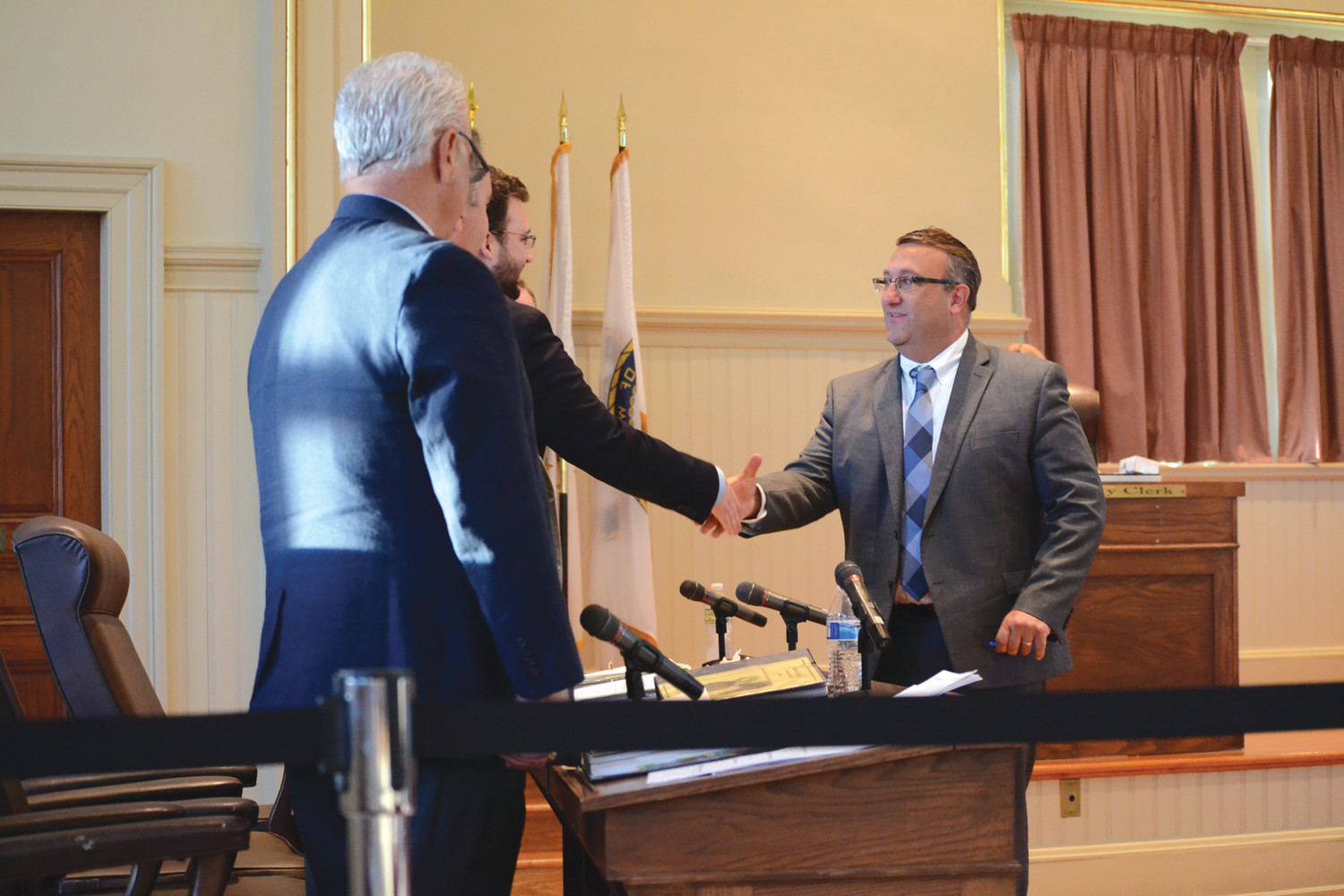 VICTORY LAP: Steve Merolla shakes the hands of his fellow council members following his nomination and approval as City Council President.