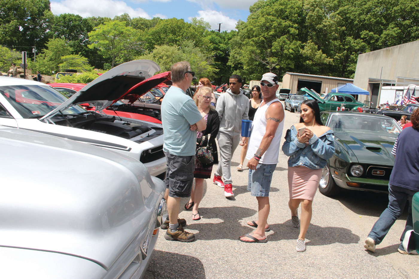 CRUISING IN STYLE: Students and car owners observed the many vintage and expensive cars brought to the show.