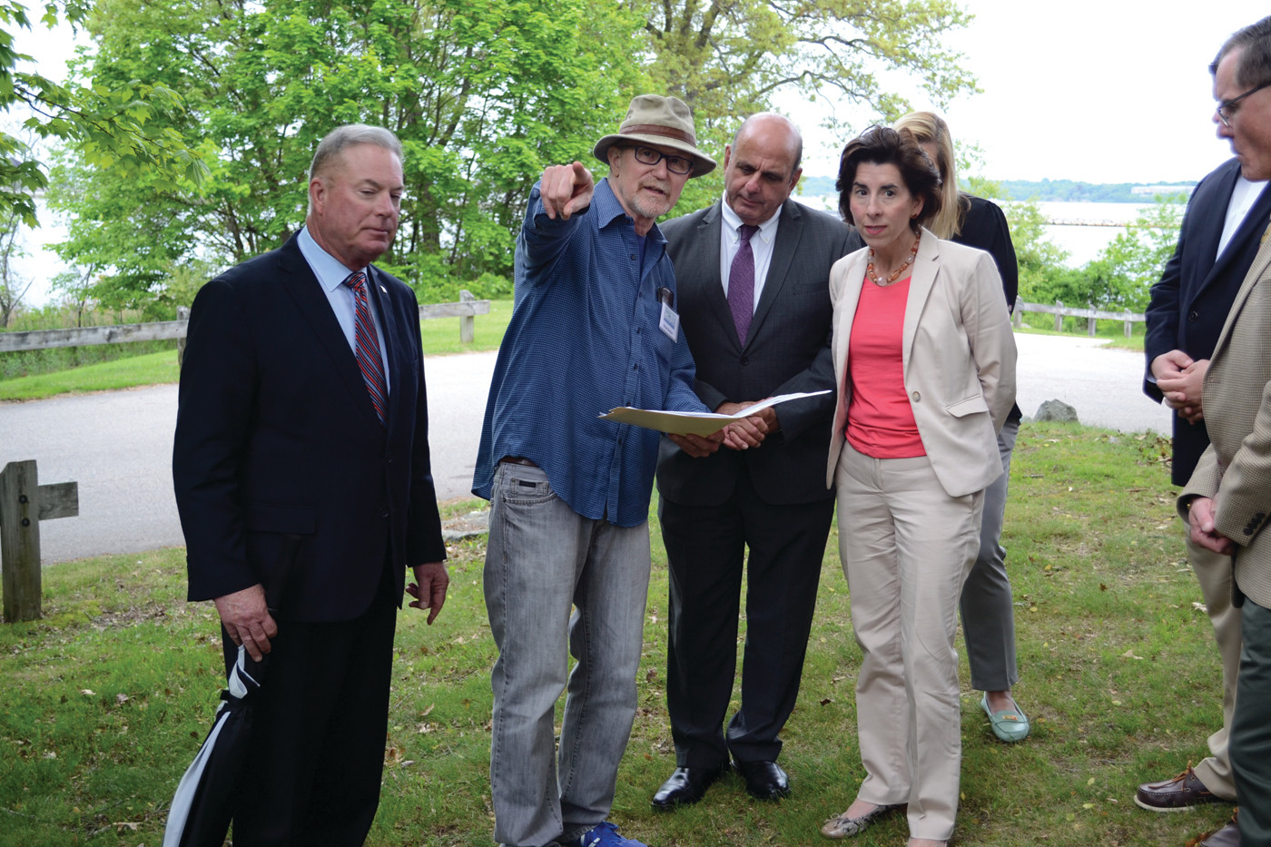 SURVEYING SALTER: Friends of Salter Grove coordinator Peter Becker (with hat) points in the direction of the playground at Salter Grove during a visit by Governor Gina Raimondo. Rep. Joseph McNamara is to his left, and acting mayor Joseph Solomon to his right.