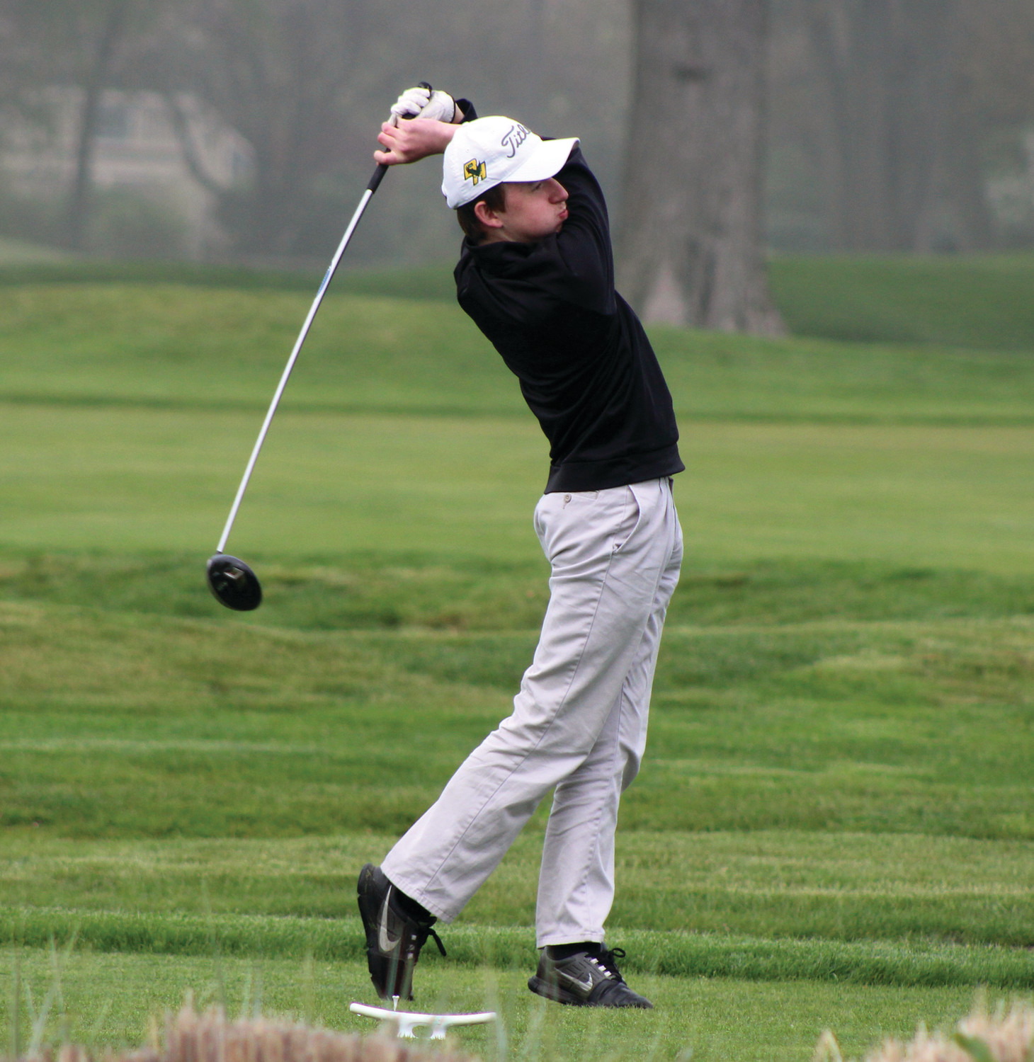 ON THE FAIRWAY: Bishop Hendricken's Justin Richard watches a drive against Toll Gate.